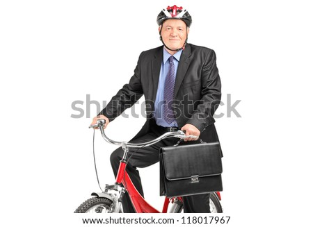 A mature businessman with briefcase on a bicycle, isolated on white background - stock photo