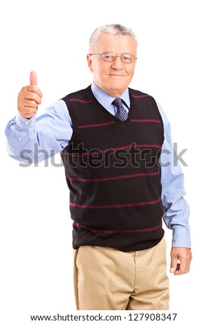 A mature gentleman giving thumbs up isolated on white background - stock photo