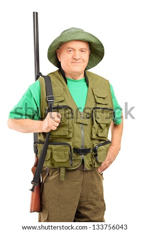 A mature hunter holding a rifle and looking at camera isolated on white background - stock photo