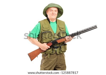 A mature male hunter holding a rifle isolated on white background - stock photo