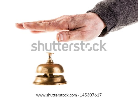 a mature old man ringing a hoted reception bell isolated over white - stock photo
