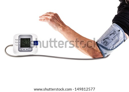 a mature woman checking the blood pressure with an automatic sphygmomanometer - stock photo