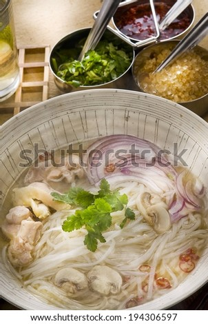 A meal of noodles, onion, meat and mushrooms. - stock photo
