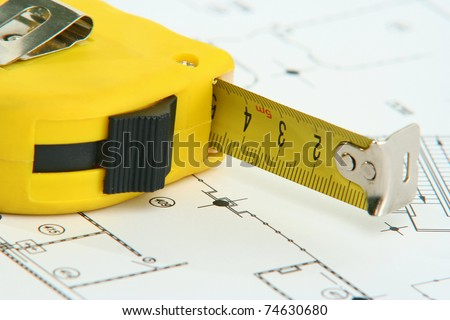 A measuring tape on a drawing - stock photo