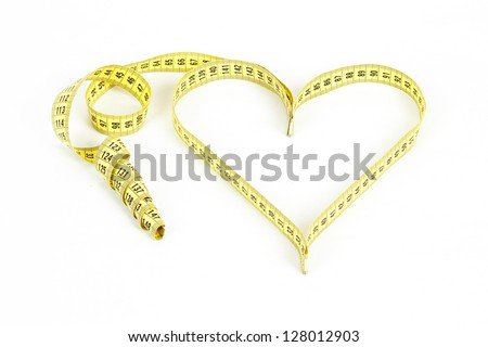 A measuring tape shaping a heart isolated on white background - stock photo