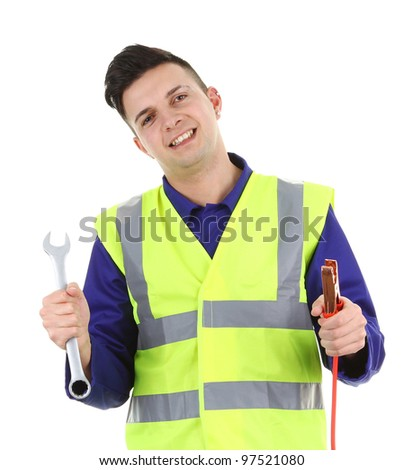 A mechanic with electrical cable and a spanner - stock photo