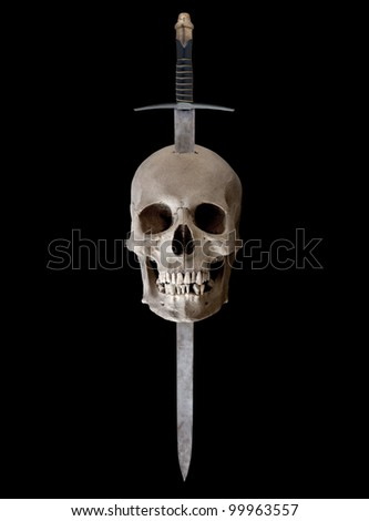 A medieval broadsword thrust through the top of a human skull - stock photo