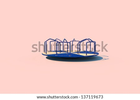 A merry-go-round in sunlight on a pink background - stock photo
