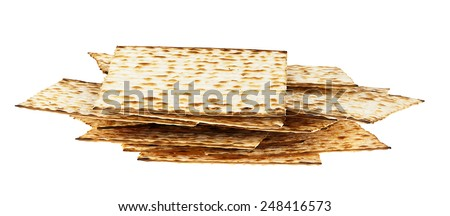 A messy pile of Jewish Matzah bread, the substitute for bread on the Jewish Passover holiday, isolated on white background. - stock photo