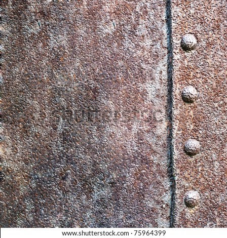 a metal texture and rivet - stock photo