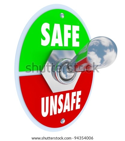 A metal toggle switch with plate reading Safe and Unsafe, switched into the Safe position, illustrating the decision to take steps to protect and safeguard your valuables, family or work - stock photo