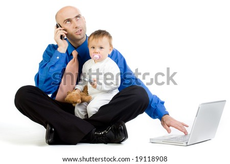 A metaphorical image of a man with his baby girl, juggling in the roles of being a businessman and a father. - stock photo
