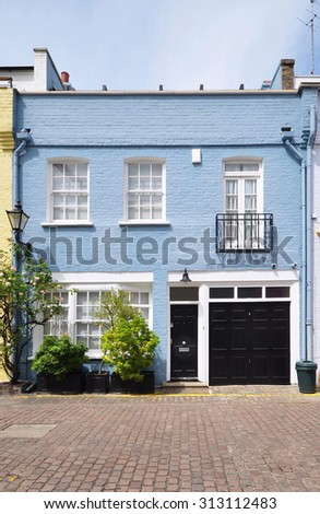 A mews house converted from an 18th century stable carriage building, in Kensington,  London, UK - stock photo