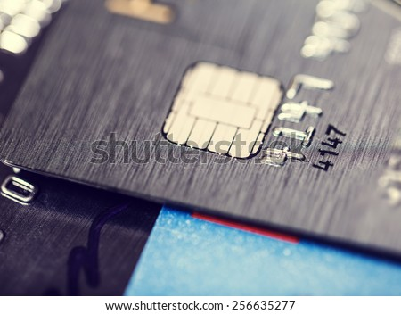 A microchip and raised numbers on a bank card  - stock photo