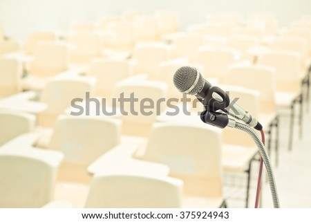 A microphone in empty classroom - stock photo