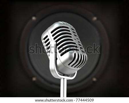 A microphone isolated against a speaker - stock photo