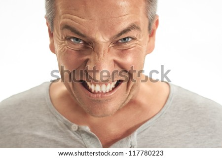 A middle age adult man is very angry about something .show teeth. Picture is toned and made in the dragan effect - stock photo