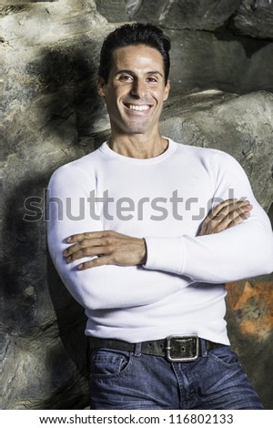 A middle age man is smilingly looking at you.../Portrait of Middle Age Man - stock photo