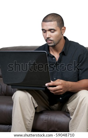 A middle aged man using a computer - stock photo