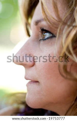 A middle aged woman in deep thought looking to the left. - stock photo