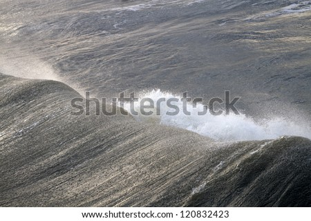 A mighty ocean wave from Hurricane Sandy viewed from behind the breaker - stock photo