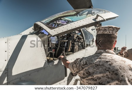 a military man open aircraft for showing the people. - stock photo