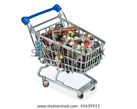 A miniature shopping cart filled with necklaces - stock photo