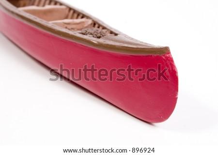 a miniature wooden canoe - stock photo
