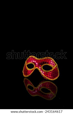 A misterious carnival mask over a black background - stock photo