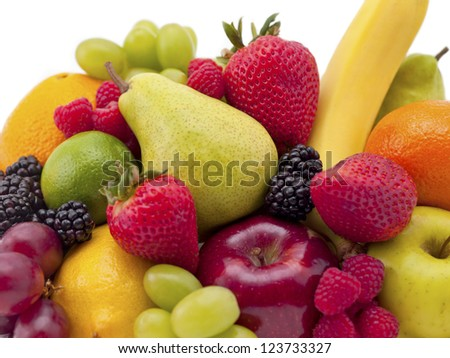 A mixture of berries, pears, citrus and bananas. - stock photo