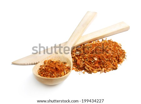 A mixture of different spices with dried onion and carrot in wooden spoon - stock photo