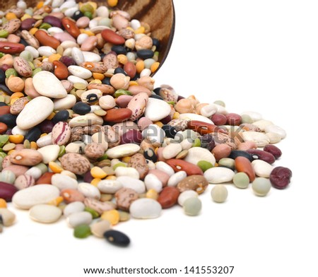 A mixture of legumes in an earthenware bowl, white background. - stock photo