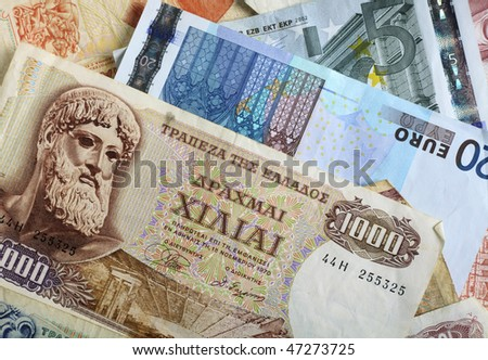 A mixture of old Greek drachma banknotes and euro notes that succeeded them. Greece's adoption of the single currency is now seen as  undermining the euro exchange rate. - stock photo