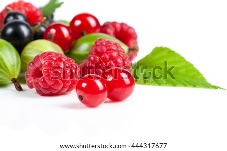 A mixture of ripe juicy fruits and berries on a white background. Raspberries, currants, gooseberries close-up. Beautiful fruit background - stock photo