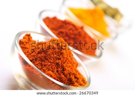 a mixture of spices, turmeric, chilli , cayenne powder and cardamom seedpods - stock photo