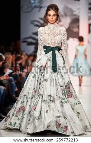 A model walks on the IGOR GULYAEV catwalk. Spring/Summer 2015. MERCEDES-BENZ FASHION WEEK RUSSIA. 26 October 2014, Moscow, Russia. - stock photo