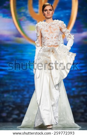 A model walks on the Valentin Yudashkin catwalk. Haute Couture, Spring/Summer 2015. March 08, 2015, Moscow, Russia - stock photo