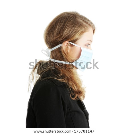 A model wearing a mask to prevent 'Swine Flu' infection. Isolated - stock photo