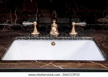 A modern bathroom - detail view of bath sink - stock photo