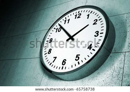 A modern clock on a grungy concrete wall - stock photo