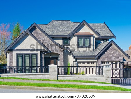 A modern custom built luxury house in a residential neighborhood.  Vancouver, Canada - stock photo