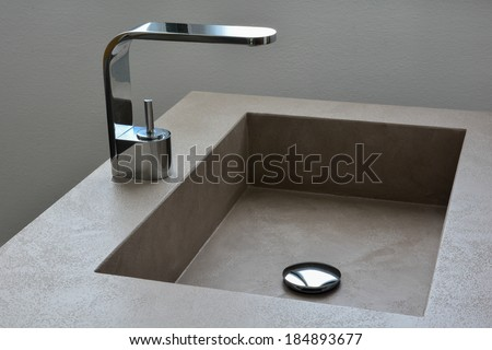 a modern grey sink with faucet - stock photo