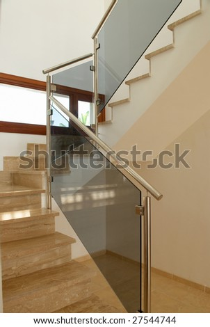 A modern marble staircase in the interior of a spanish villa - stock photo