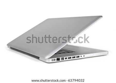 A modern metallic laptop that is half way open displayed from the side view on a white background - stock photo