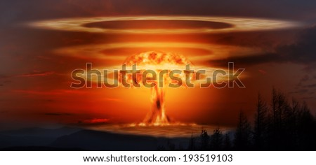 A modern nuclear bomb explosion in the mountains - stock photo