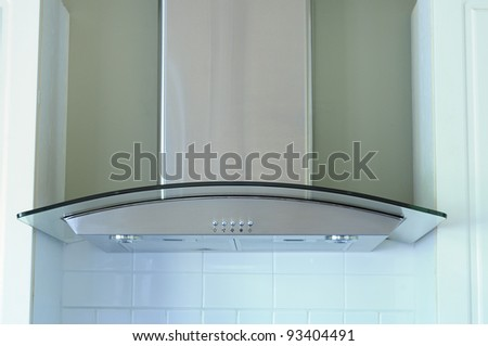 A Modern Stainless Steel And Glass Range Hood Extractor Fan - stock photo