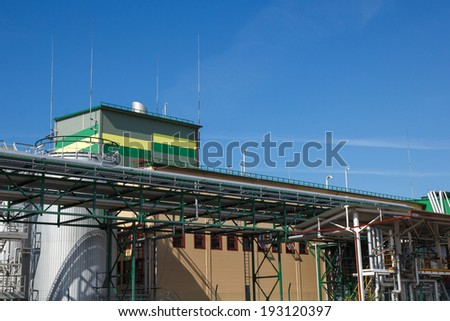 A modernistic looking biological fuel factory exterior - stock photo