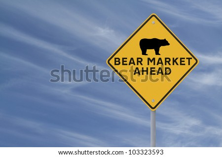A modified road sign warning of a �bear market� ahead on a blue sky background with copy space - stock photo