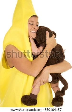 A mom with a smile hugging her little monkey close. - stock photo