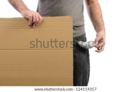 A moneyless man holding a cardboard sign with his pocket emptied out. - stock photo